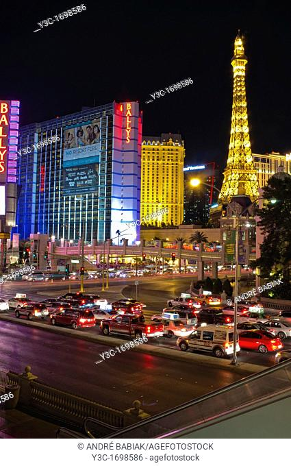 Ballys Hotel and Eiffel Tower Replica of the Paris Hotel overlooking the Las Vegas Boulevard at night