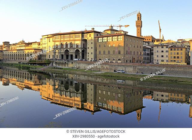 The Uffizi Gallery and Galileo Museum and their reflection in the River Arno at early evening, Florence, Tuscany, Italy, Europe