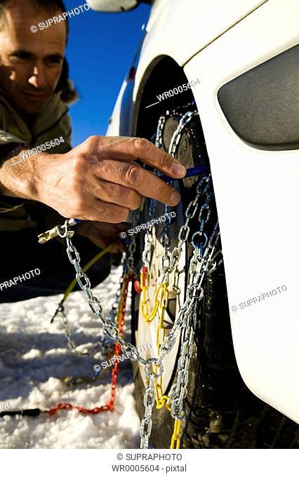Man car snow chains