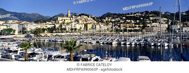 From the jetty in sunrise, view of Menton in the background and its yachting harbour in the foreground
