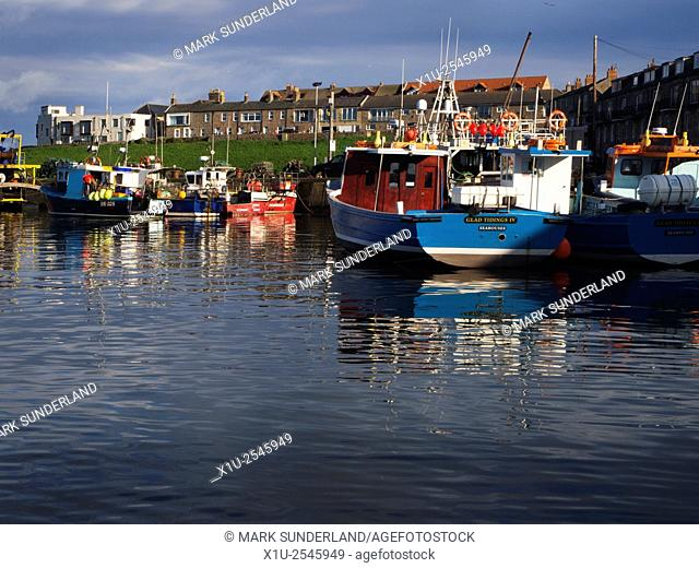 Boats in the Harbour at Seahouses at Sunset Northumberland England