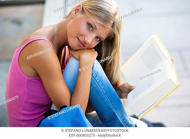 Beautiful student studying outdoors