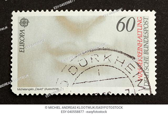 GERMANY - CIRCA 1980: Stamp printed in Germany shows a close-up of a face, circa 1980