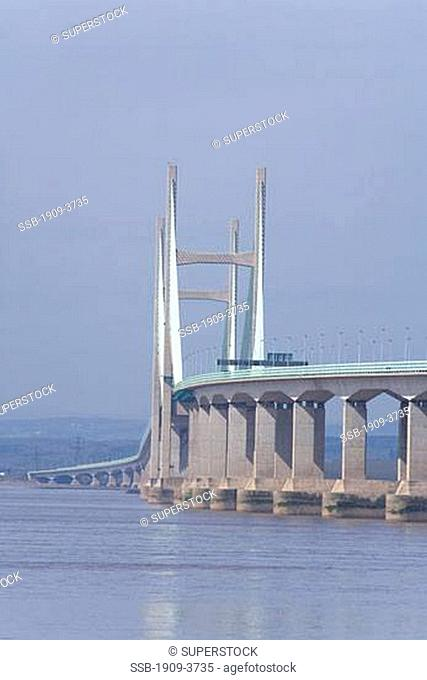 New Severn Bridge across the River Severn estuary that divides England from Wales on sunny spring day with blue sky Gloucester Gloucestershire Glos UK United...