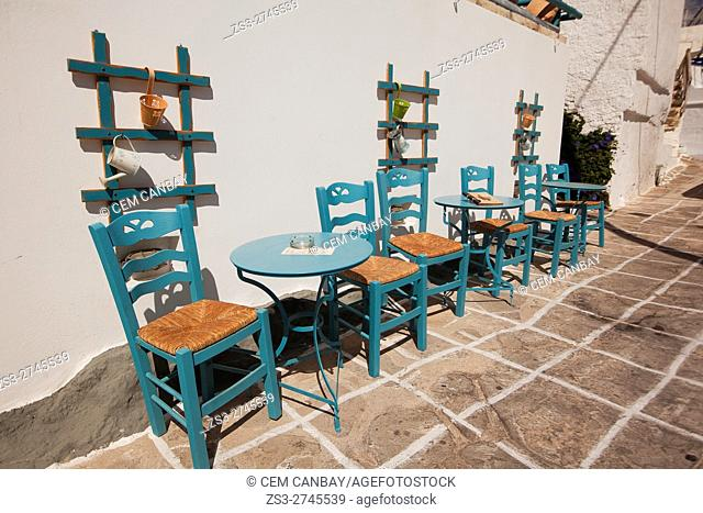 Blue chairs and tables of a traditional Greek cafe-restaurant in the old town Chora or Chorio, Kimolos, Cyclades Islands, Greek Islands, Greece, Europe