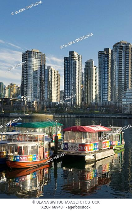 Aquabus ferry in False Creek in front of condominiums of Yaletown in downtown Vancouver British Columbia Canada