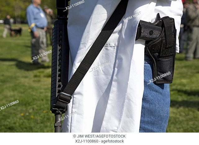 Alexandria, Virgina - Pro-gun activists openly carry firearms in a rally at Fort Hunt One participant was a medical doctor wearing a lab coat and carrying a...