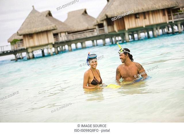 Couple snorkelling in bora bora