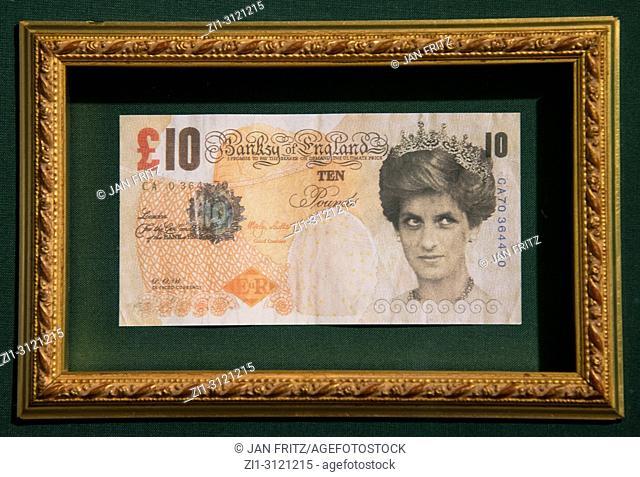 """Money Ladi Di Face"". Banksy exhibition. Moco Museum. Amsterdam. Netherlands"