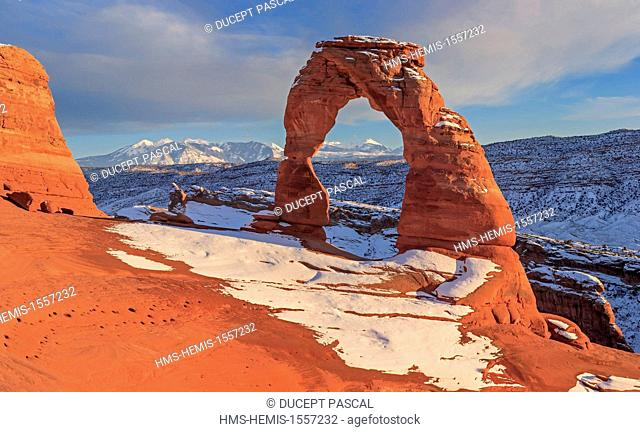 United States, Utah, Colorado Plateau, Arches National Park, Delicate Arch at sunset in winter after a snowstorm