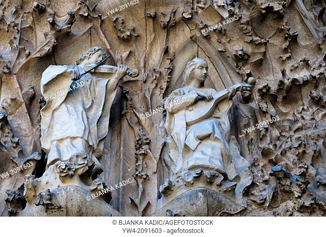 Sculptural detail of the Nativity Facade, Violin and lute players, Sagrada Familia, Barcelona, Catalonia, Spain