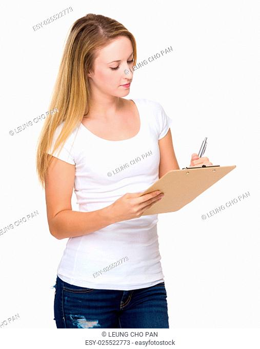 Woman write on clipboard