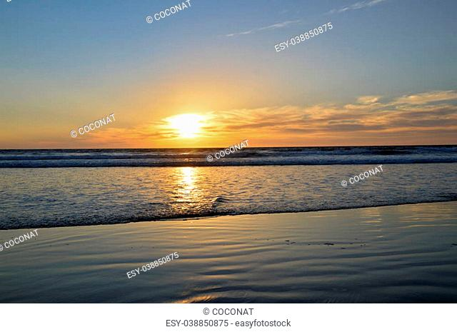 Sunset ocean cool water beautiful sun in the sky