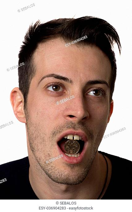 Man holding a romanian coin in the mouth, isolated over white