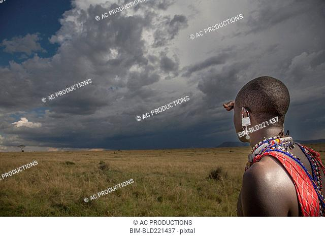 Black man in traditional clothing admiring view