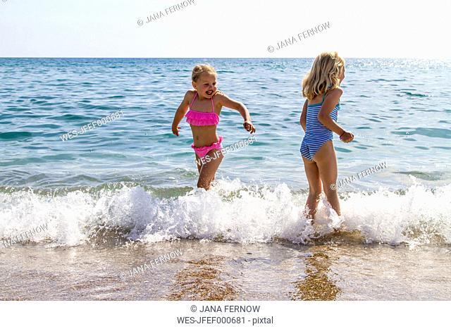 Greece, Corfu, Agios Georgios, two little girls bathing