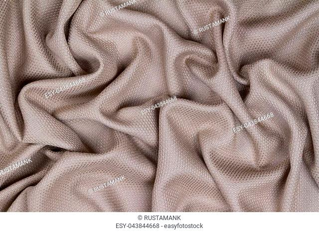 Lilac woolen crumpled wrinkled fabric with waves, background crumpled tissue