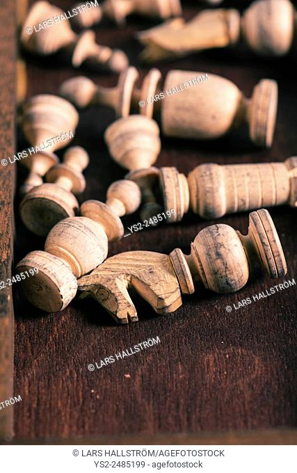Chess pieces in wooden box. Conceptual image of strategy and competition