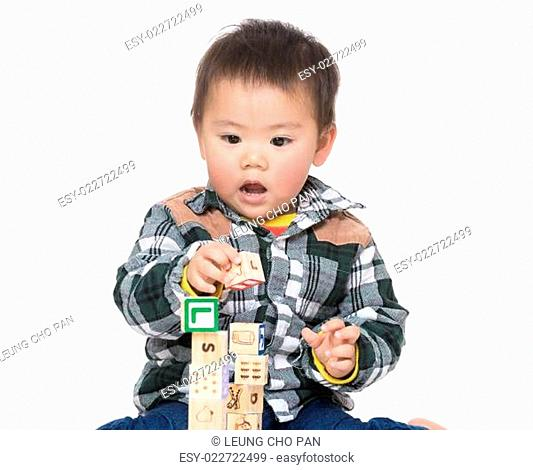 Asia baby boy play wooden toy block