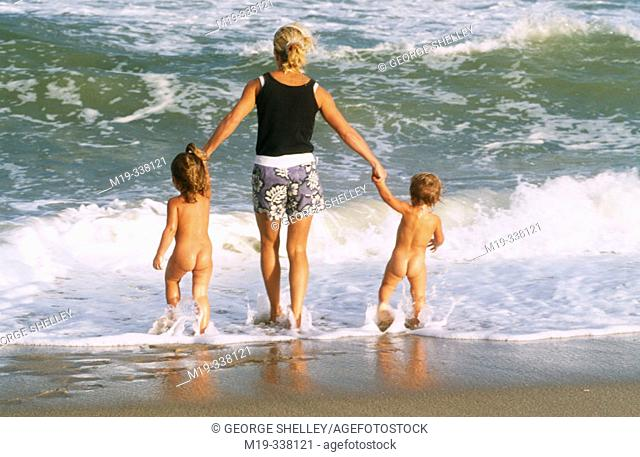 mother with her children at the beach