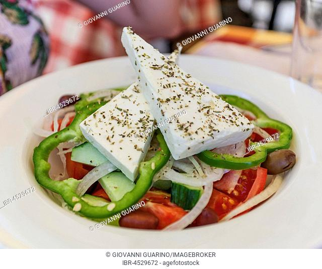 Greek salad with tomatoes, peppers, feta cheese, cucumbers and olives