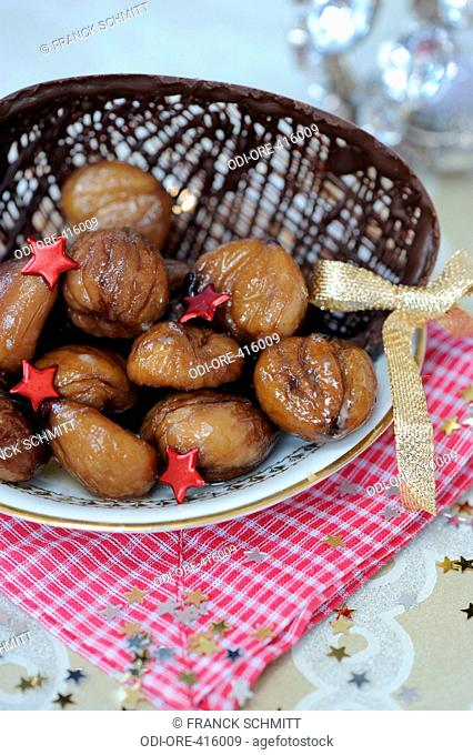 Glazed chestnuts in a chocolate bowl