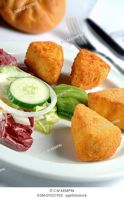 Fried Camembert cheese with cranberries