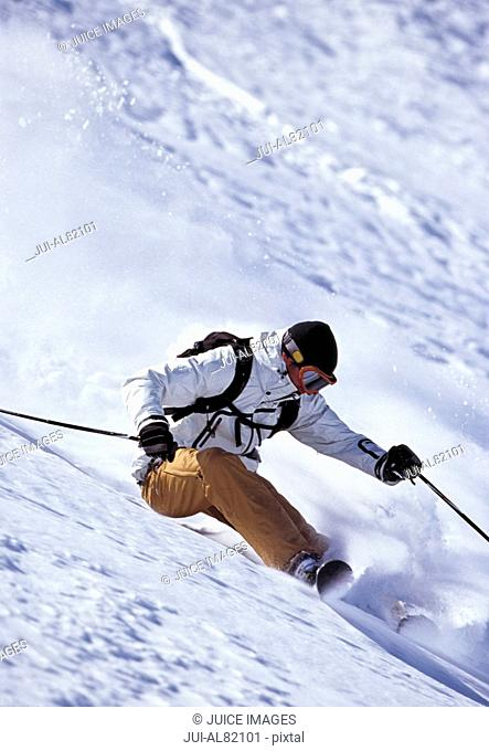 Person skiing down mountain