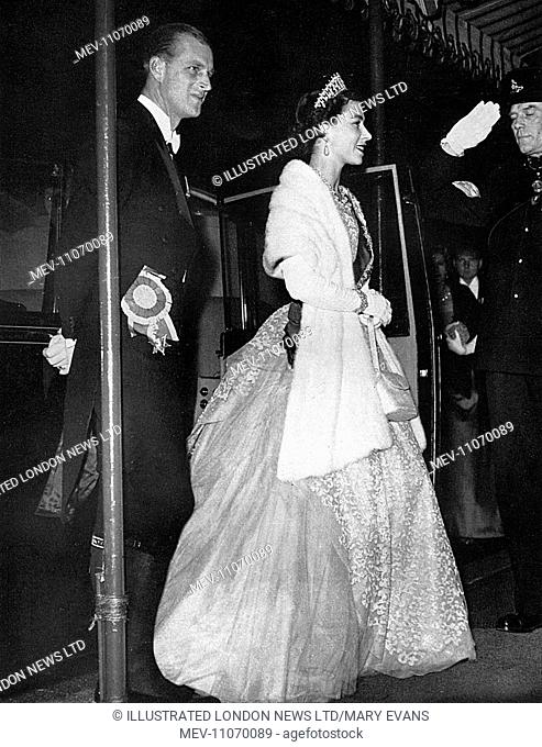 Queen Elizabeth II and Prince Philip, Duke of Edinburgh, arriving at the Ethiopian Embassy for a private dinner party given by the Emperor of Ethiopia (Haile...