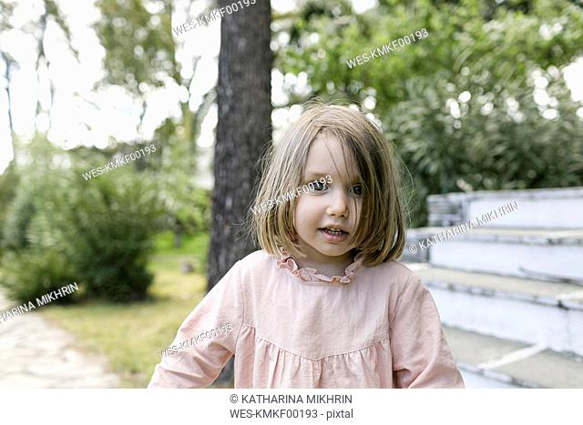 Portrait of little girl in the garden