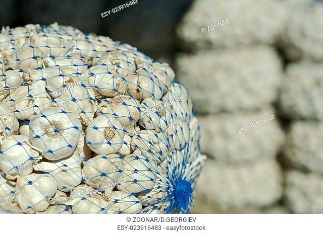 Mesh bag with garlic