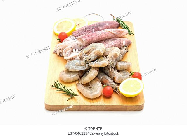 fresh seafood raw (shrimps ,squids) on wooden board isolated on white background