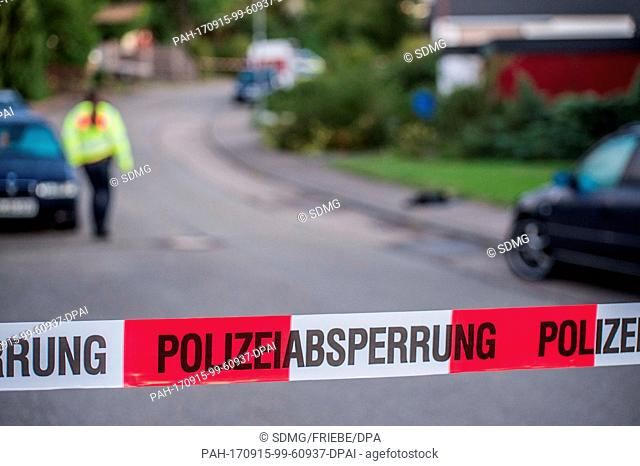 A police cordon across a street in a residential area in Villingendorf, Germany, 15 September 2017. A man, a woman and a 6-year-old boy have been shot dead in a...