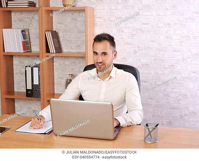 Image representing a young man doing work in the office or at home