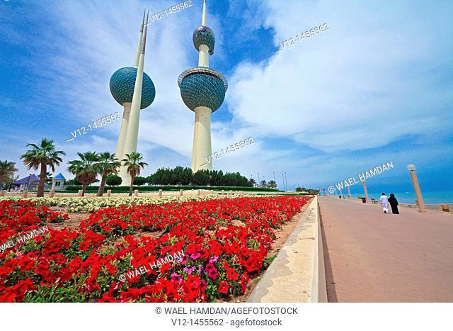 Kuwaiti couple walking by The Kuwait Towers, Dasman area, kuwait city