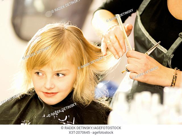 hair care - little girl at a hairdressing salon