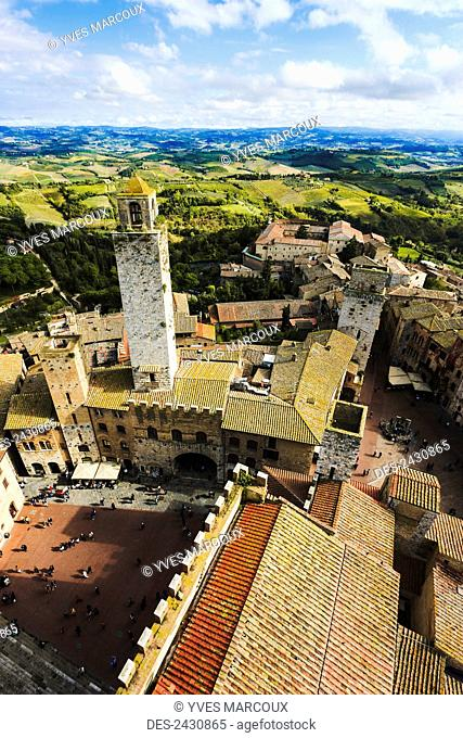 Stone tower and rooftops; San Gimignano, Tuscany, Italy