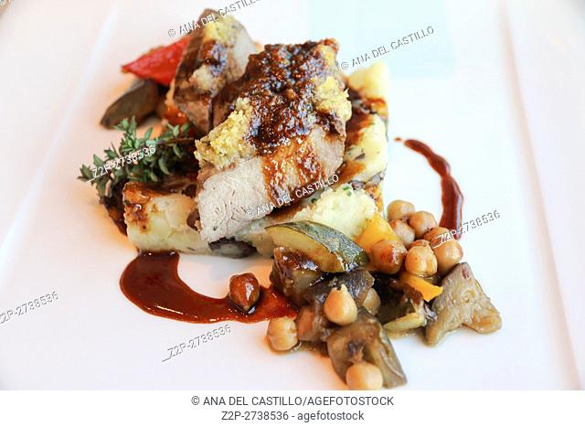 Gourmet dish, pork meat on potato puree and chickpeas Zurich