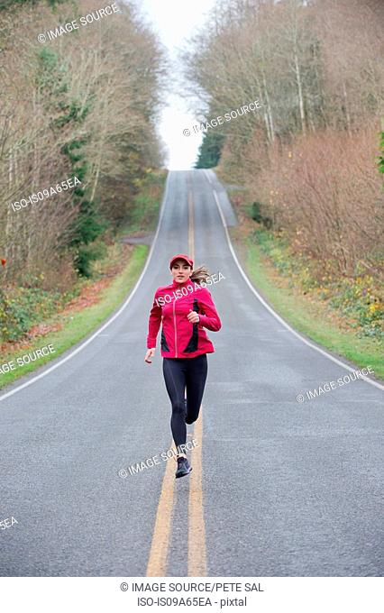 Woman running on rural road