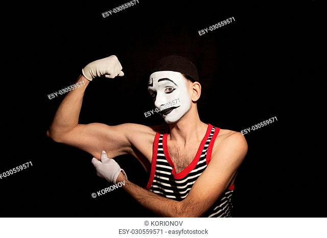 Portrait of mime actor on black background closeup