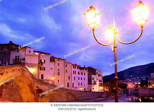 Stone bridge Ponte Vecchio across the Nervia river with residential buildings, Dolceacqua, Liguria, Italy, Europe
