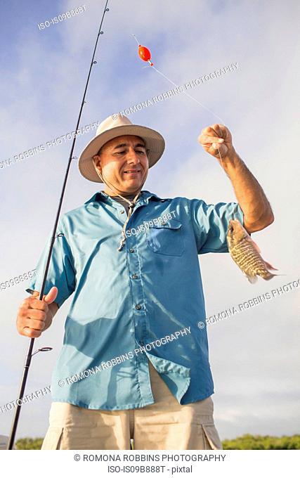 Man holding mangrove snapper
