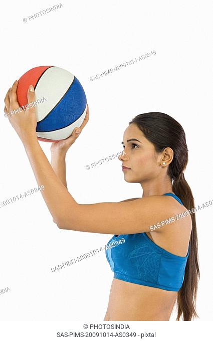 Close-up of a woman holding a volleyball