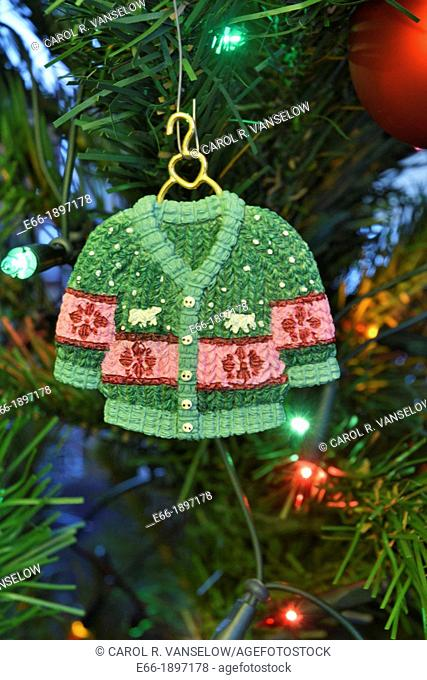 In addition to glass ball and lights, many people put handmade ornaments on their Christmas tree Ceramic cardigan sweater