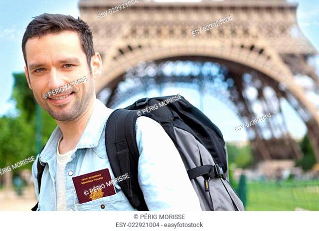 Young attractive traveler in Paris with passport