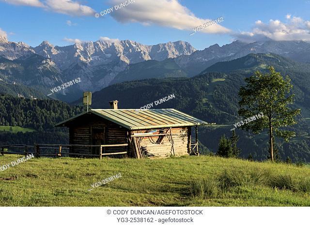 Old mountain barn with Wetterstein mountains in background, Garmisch-Partenkirchen, Bavaria, Germany