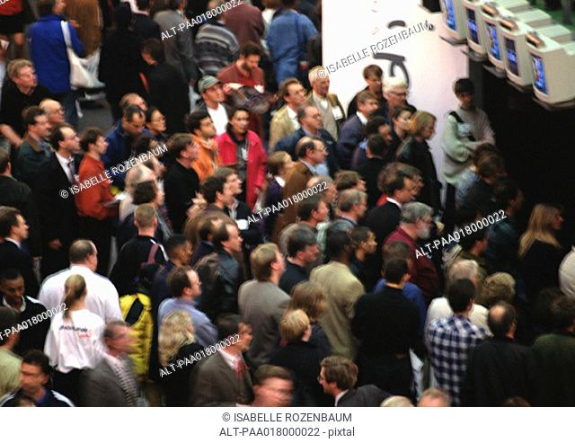 Crowd of people near television monitors, blurred