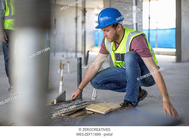 Construction worker on construction site checking work