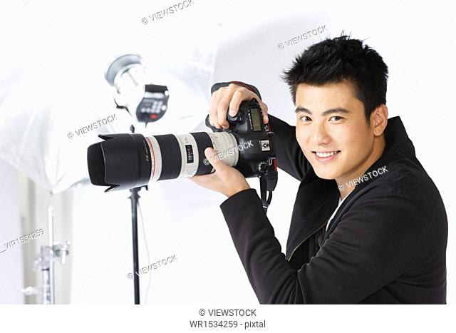 Eastern photographer with a camera