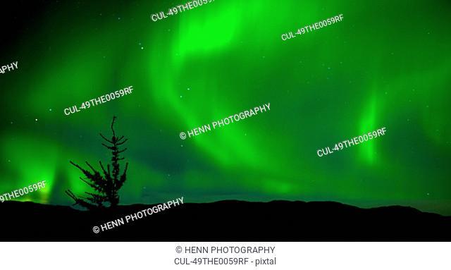 Northern lights over rural landscape